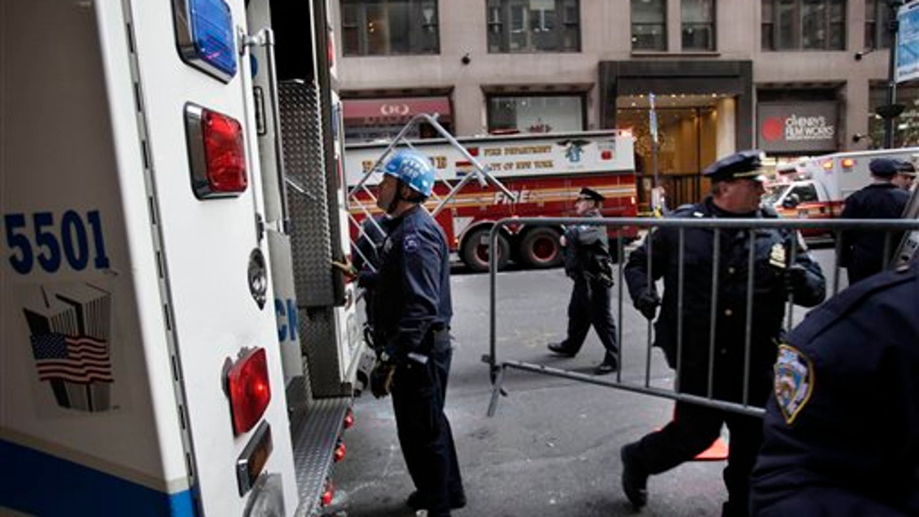 Dec. 14: Emergency personnel gather outside of a building where there was an elevator accident in New York. A woman was killed when her foot or leg became caught in an elevator's closing doors, New York City fire officials said Wednesday.