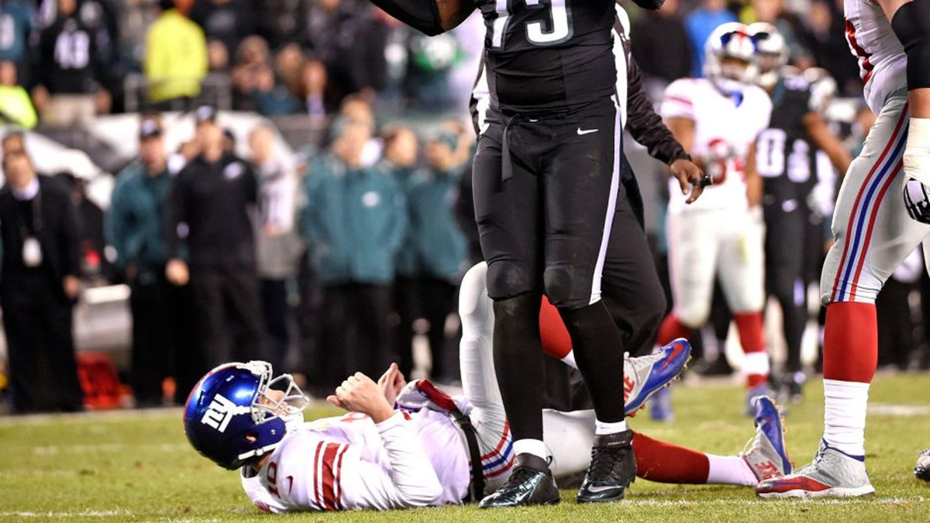 Oct 19, 2015; Philadelphia, PA, USA; Philadelphia Eagles defensive end Vinny Curry (75) reacts after pressuring New York Giants quarterback Eli Manning (10) into intentional grounding during the fourth quarter at Lincoln Financial Field. The Eagles defeated the Giants, 27-7. Mandatory Credit: Eric Hartline-USA TODAY Sports