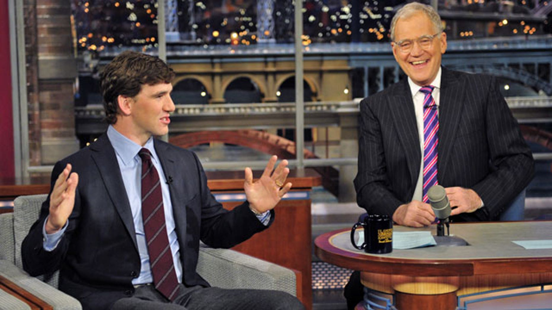 "Feb. 6: n this image released by CBS, Super Bowl MVP Eli Manning, of the New York Giants, left, is shown with host David Letterman on ""Late Show with David Letterman."" (AP)"