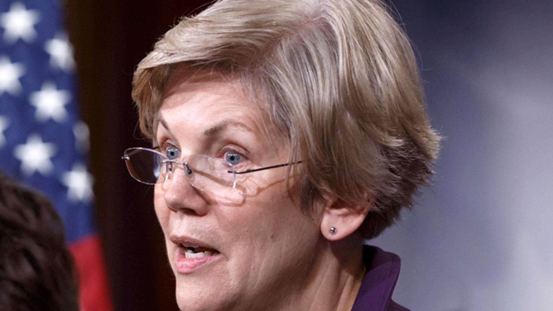 In this Dec. 10, 2014 file photo, Sen. Elizabeth Warren, D-Mass., speaks on Capitol Hill in Washington.