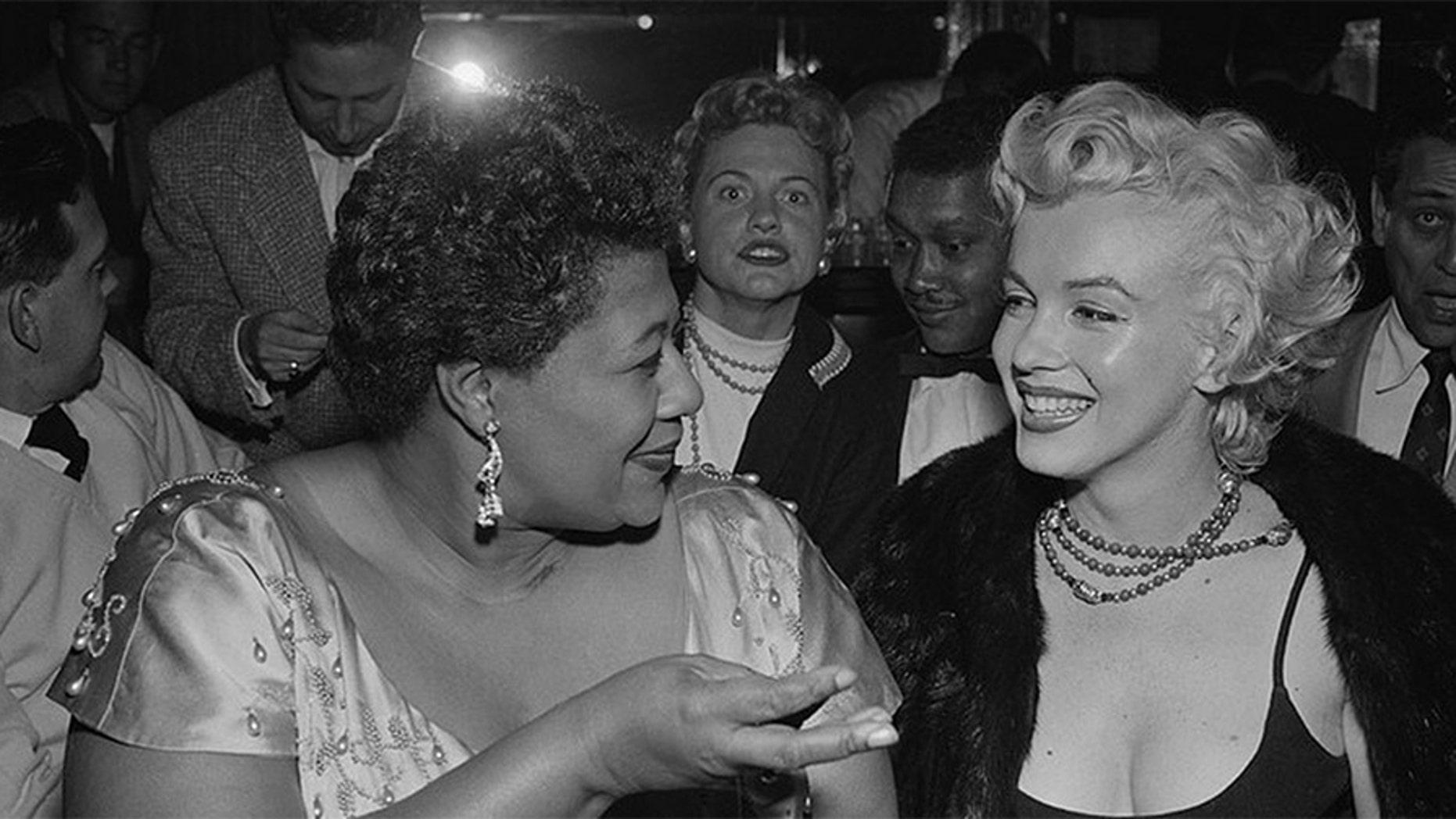 Ella Fitzgerald with Marilyn Monroe.