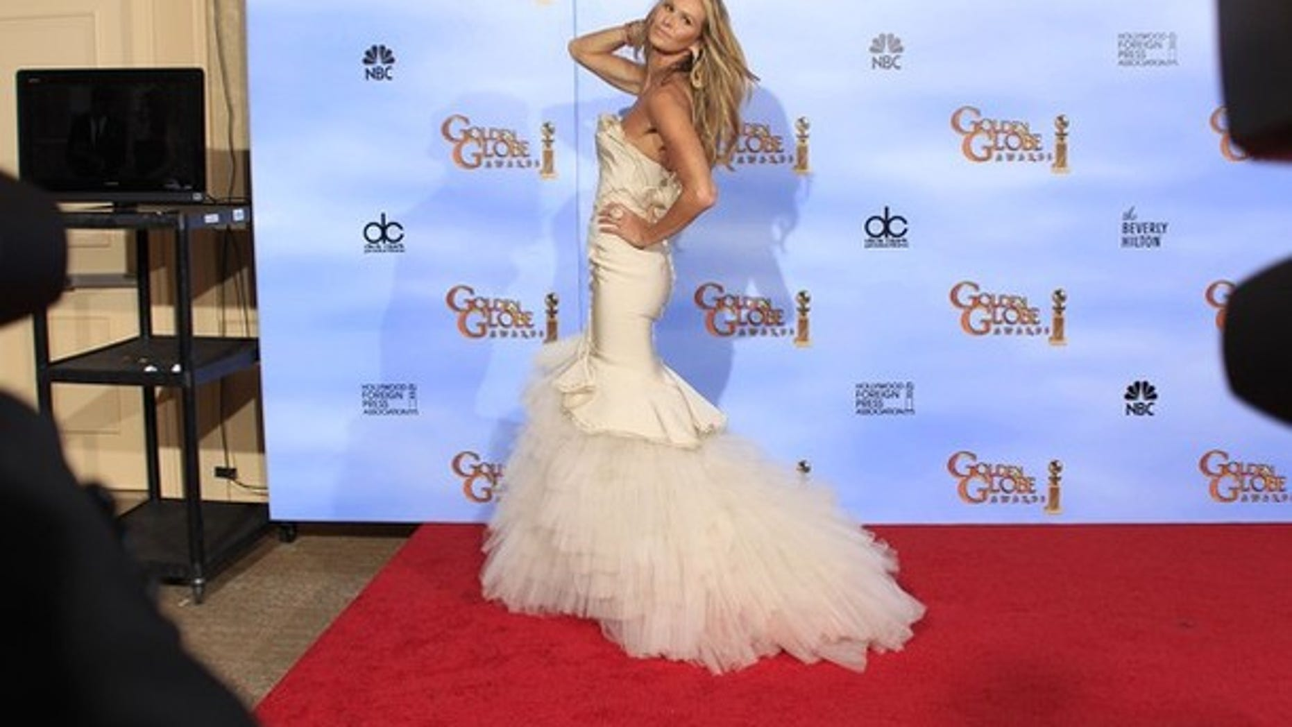 Model Elle Macpherson poses backstage at the 69th annual Golden Globe Awards in Beverly Hills, California, January 15, 2012.