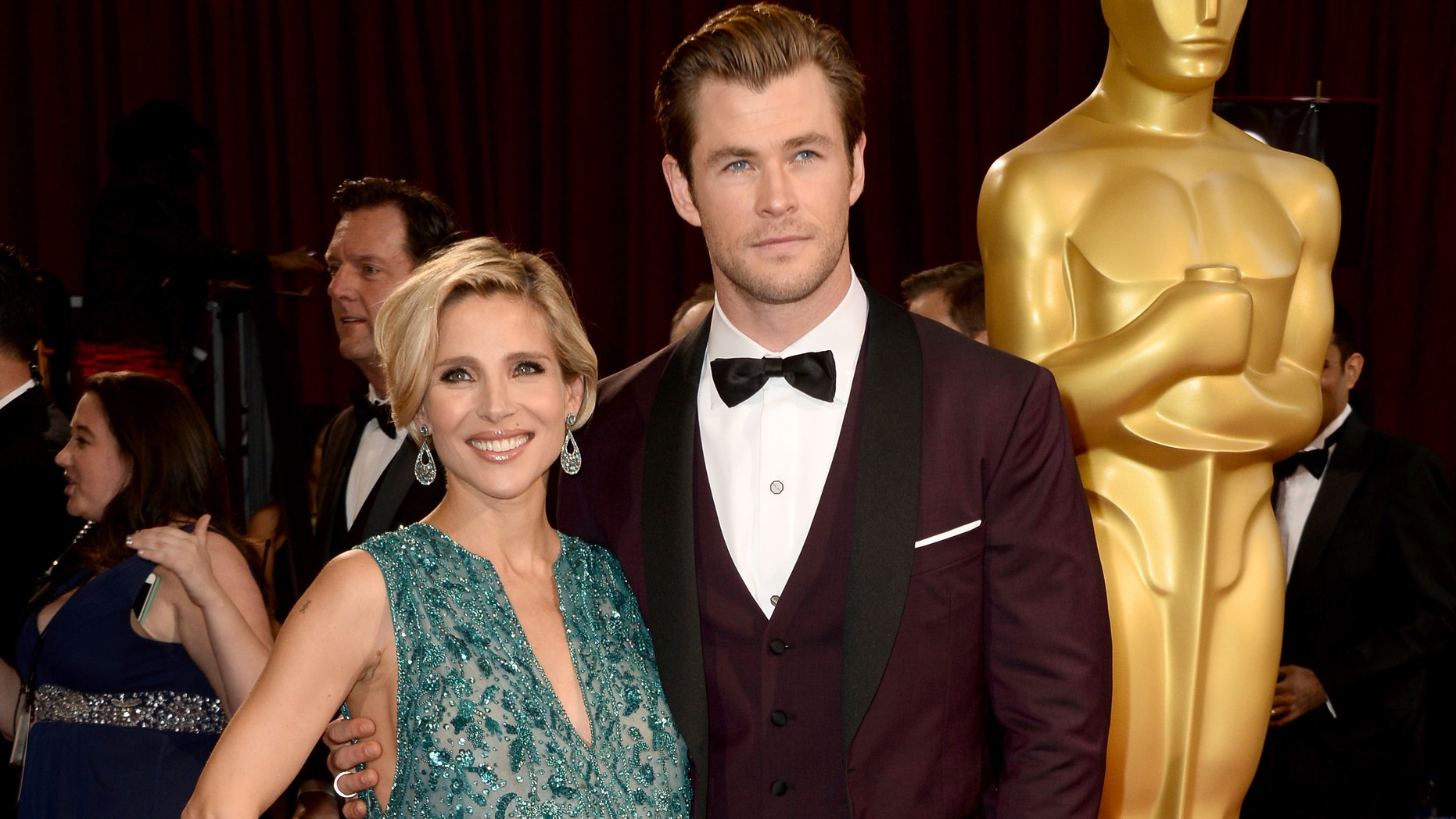 HOLLYWOOD, CA - MARCH 02:  Actors Elsa Pataky (L) and Chris Hemsworth attend the Oscars held at Hollywood & Highland Center on March 2, 2014 in Hollywood, California.  (Photo by Frazer Harrison/Getty Images)