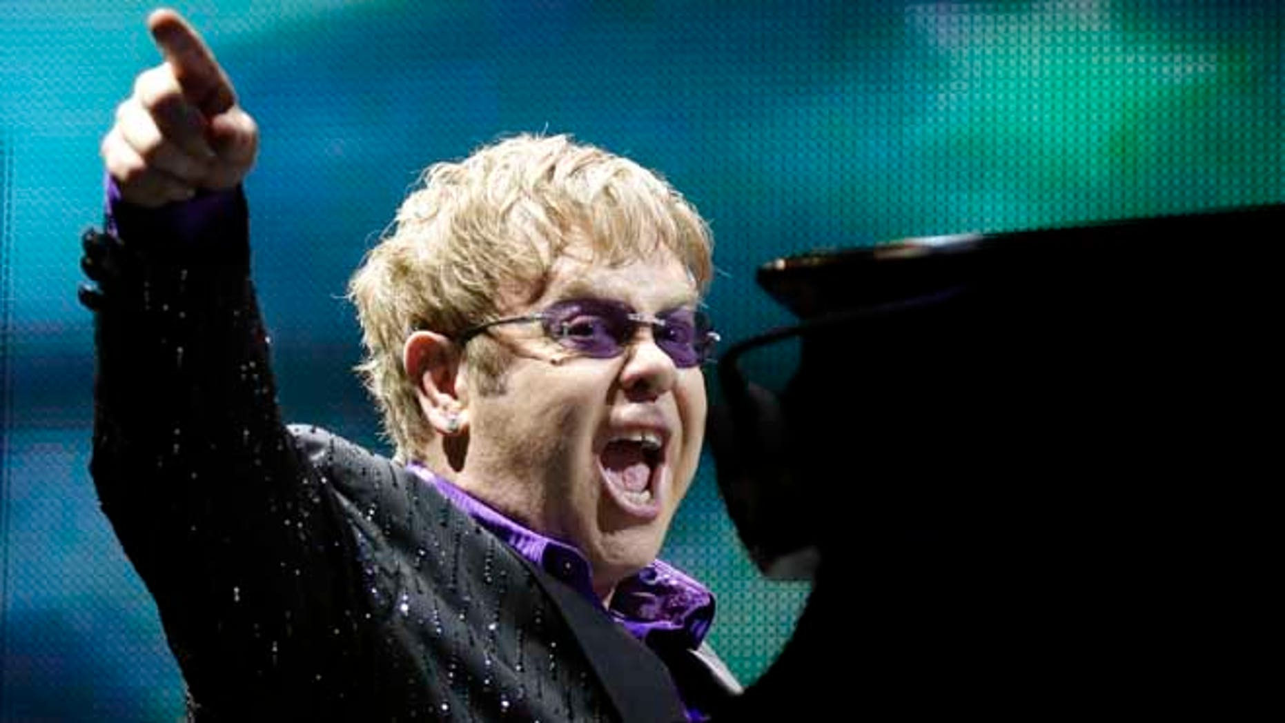This June 30, 2012 file photo shows British pop star Elton John performing during the Euro 2012 soccer championship in Kiev, Ukraine.