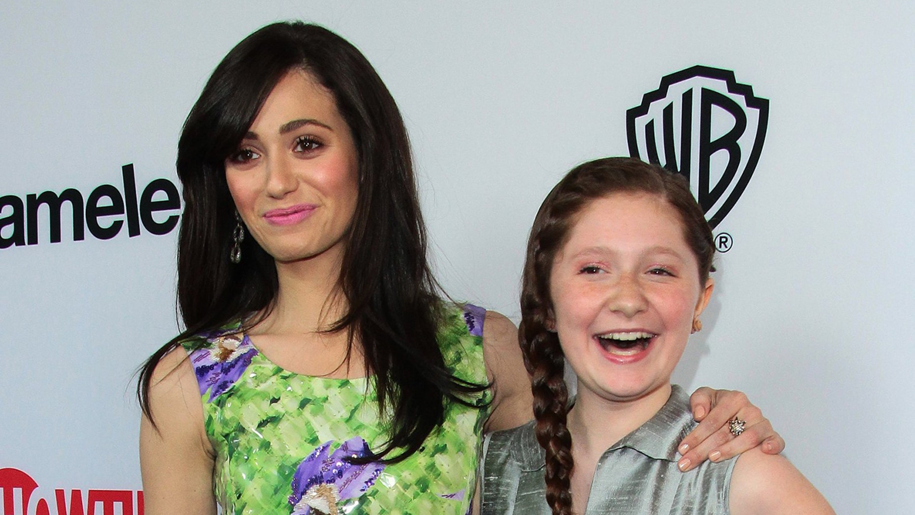 """""""Shameless"""" stars Emmy Rossum, left, and Emma Kenney, right, in 2013. Rossum is leaving the show after the ninth season."""