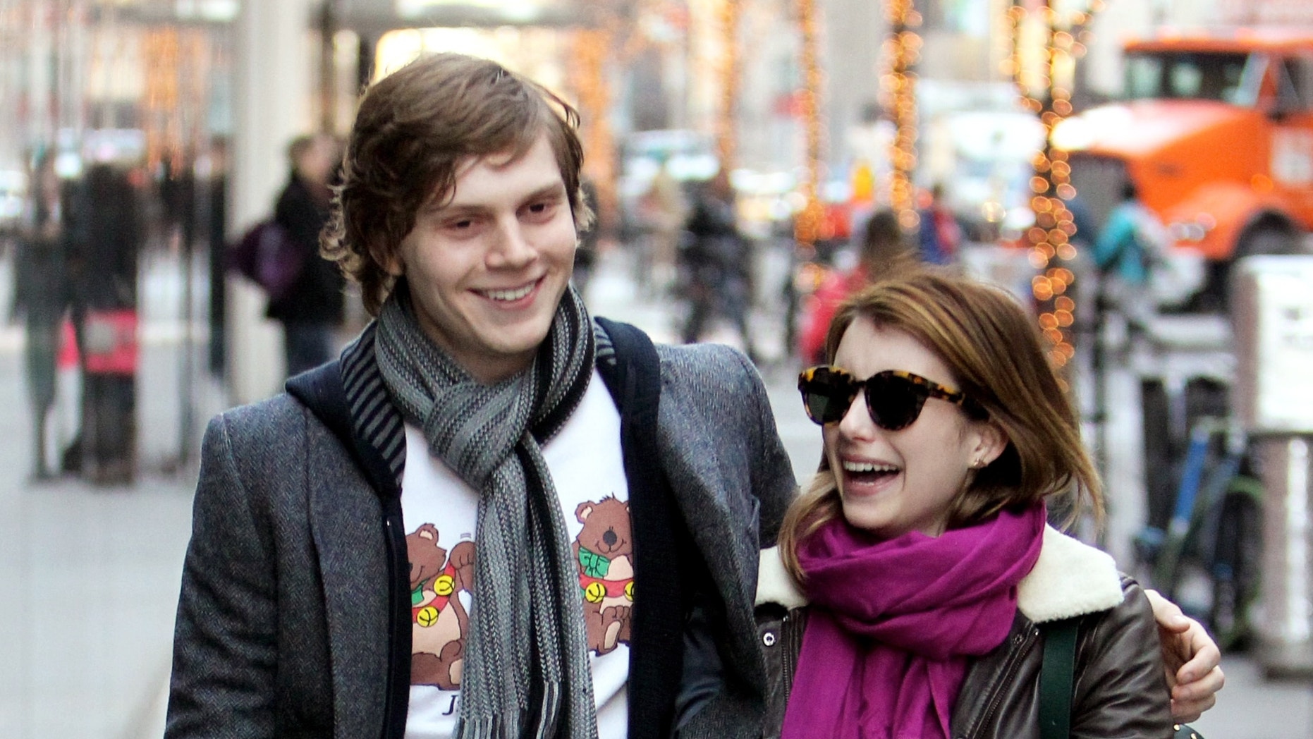 Evan Peters and Emma Roberts walk together in New York City.