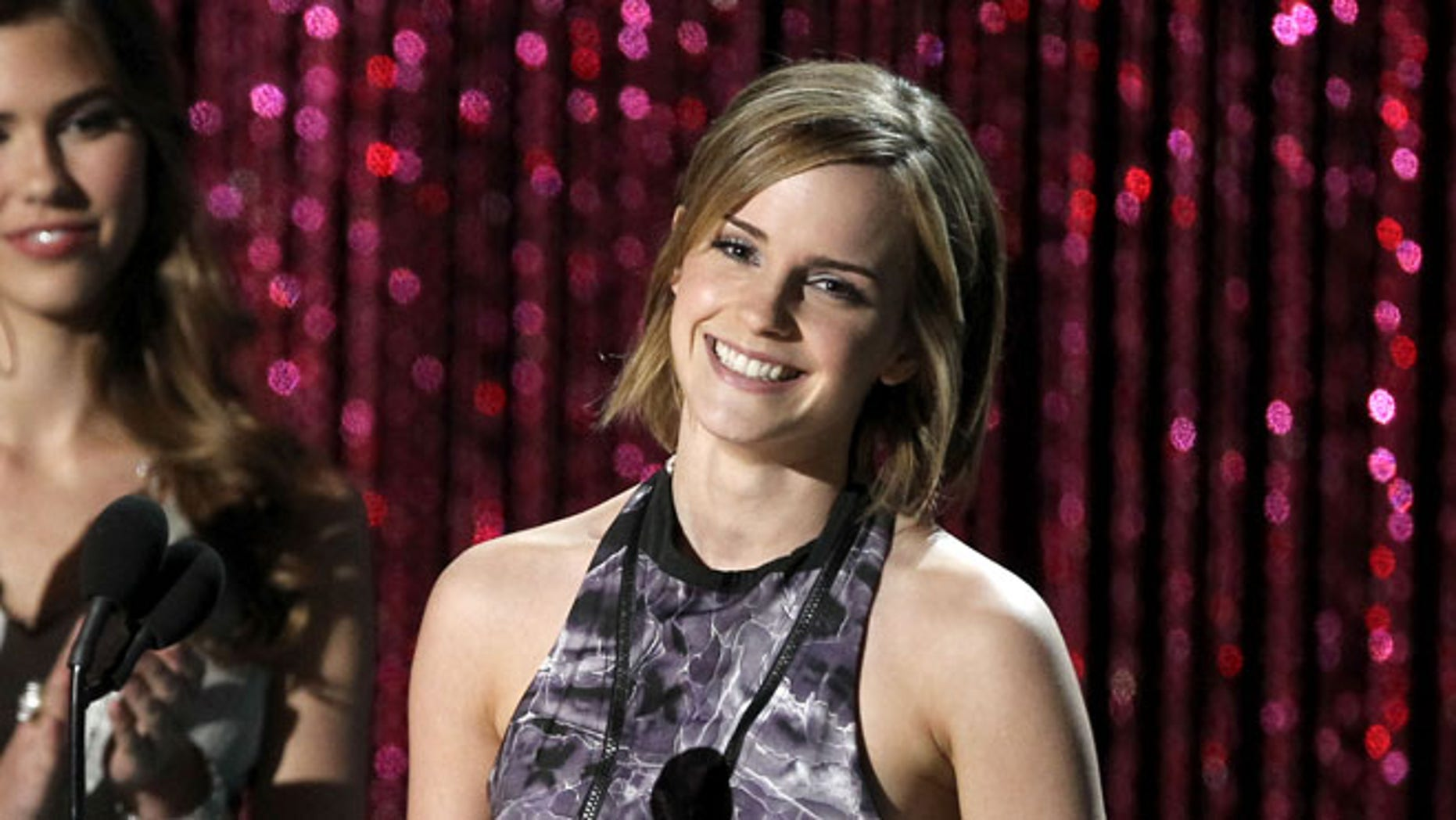 """Emma Watson accepts the award for best cast for """"Harry Potter and the Deadly Hallows Part 2"""" during the MTV Movie Awards on Sunday, June 3, 2012, in Los Angeles. (Photo by Matt Sayles/Invision/AP)"""