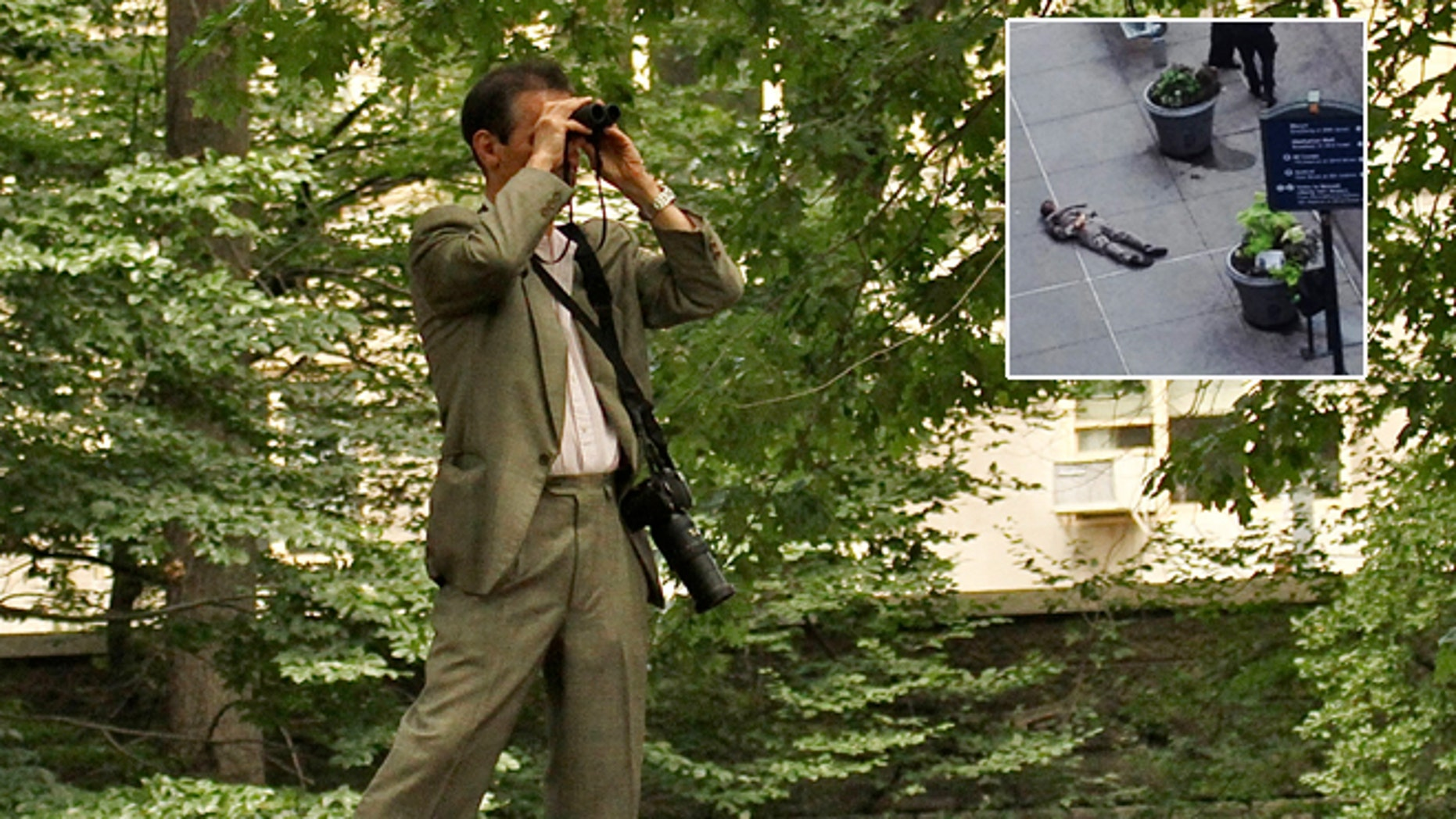In this June 30, 2012 photo provided by Jean Shum, Jeffrey Johnson goes bird watching in New York's Central Park. Johnson was killed by police gunfire after he fatally shot an executive at his former company.