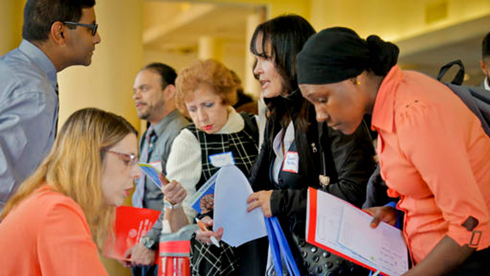 Job seekers attend the New York Department of Citywide Administrative Services (DCAS) 2016 job fair, Wednesday Nov. 2, 2016, in New York.   U.S. employers added a decent 161,000 jobs in October 2016 and raised pay sharply for many workers. It was the final major report on a lukewarm but durable economy before Americans choose a new president next week. (AP Photo/Bebeto Matthews)