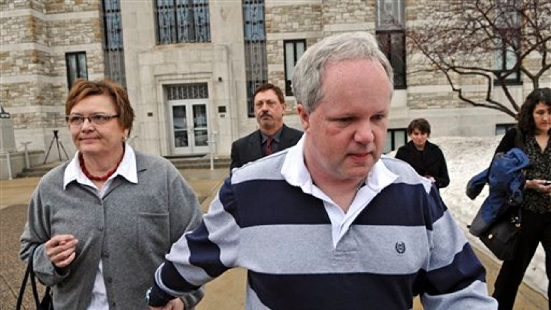 Feb. 17: William Melchert-Dinkel leaves the Rice County Courthouse holding hands with his wife, Joyce Melchert-Dinkel, after waiving his right to a jury trial in Faribault, Minn. (AP/Star Tribune)