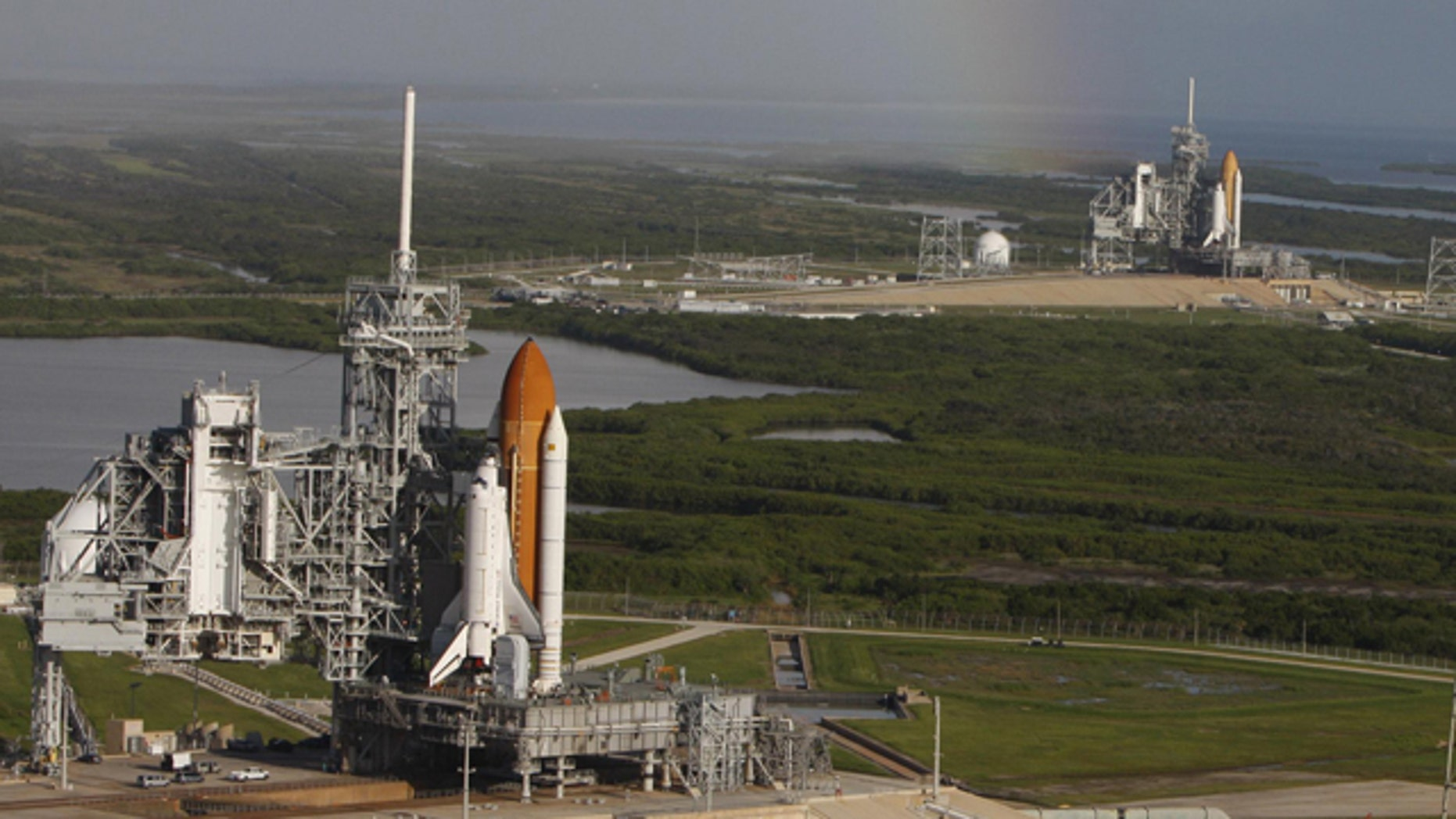 Space shuttle Atlantis (foreground) sits on Launch Pad A and Endeavour on Launch Pad B at NASA's Kennedy Space Center in Florida. Endeavour's final launch is scheduled for April 1.