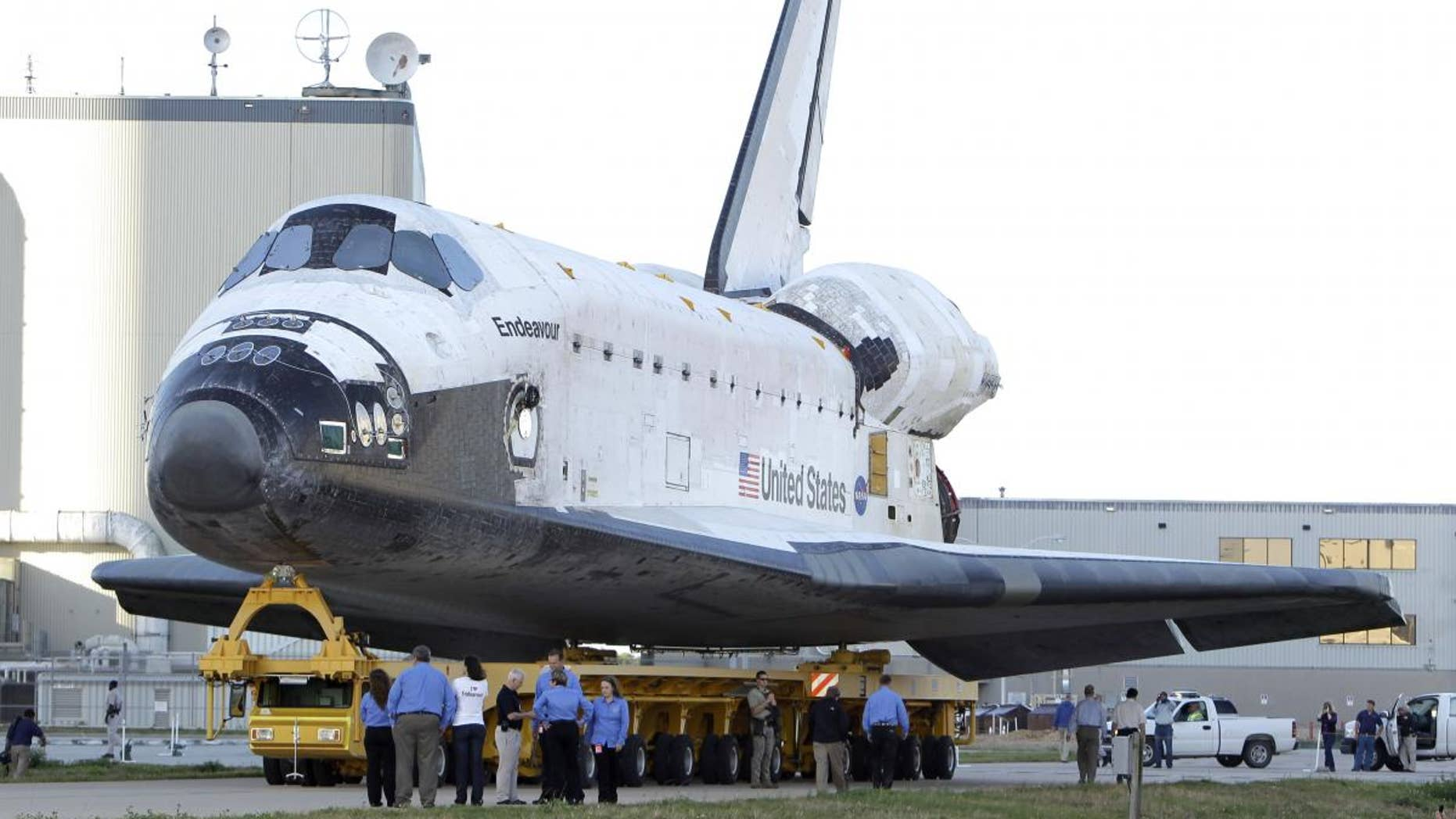 Space shuttle Endeavour is transported from the Orbital Processing Facility to the Vehicle Assembly Building where the orbiter will be connected to the external fuel tank and twin solid rocket boosters at the Kennedy Space Center in Cape Canaveral, Fla., Monday, Feb. 28, 2011. Endeavour is schedule to launch April 19.(AP Photo/John Raoux)