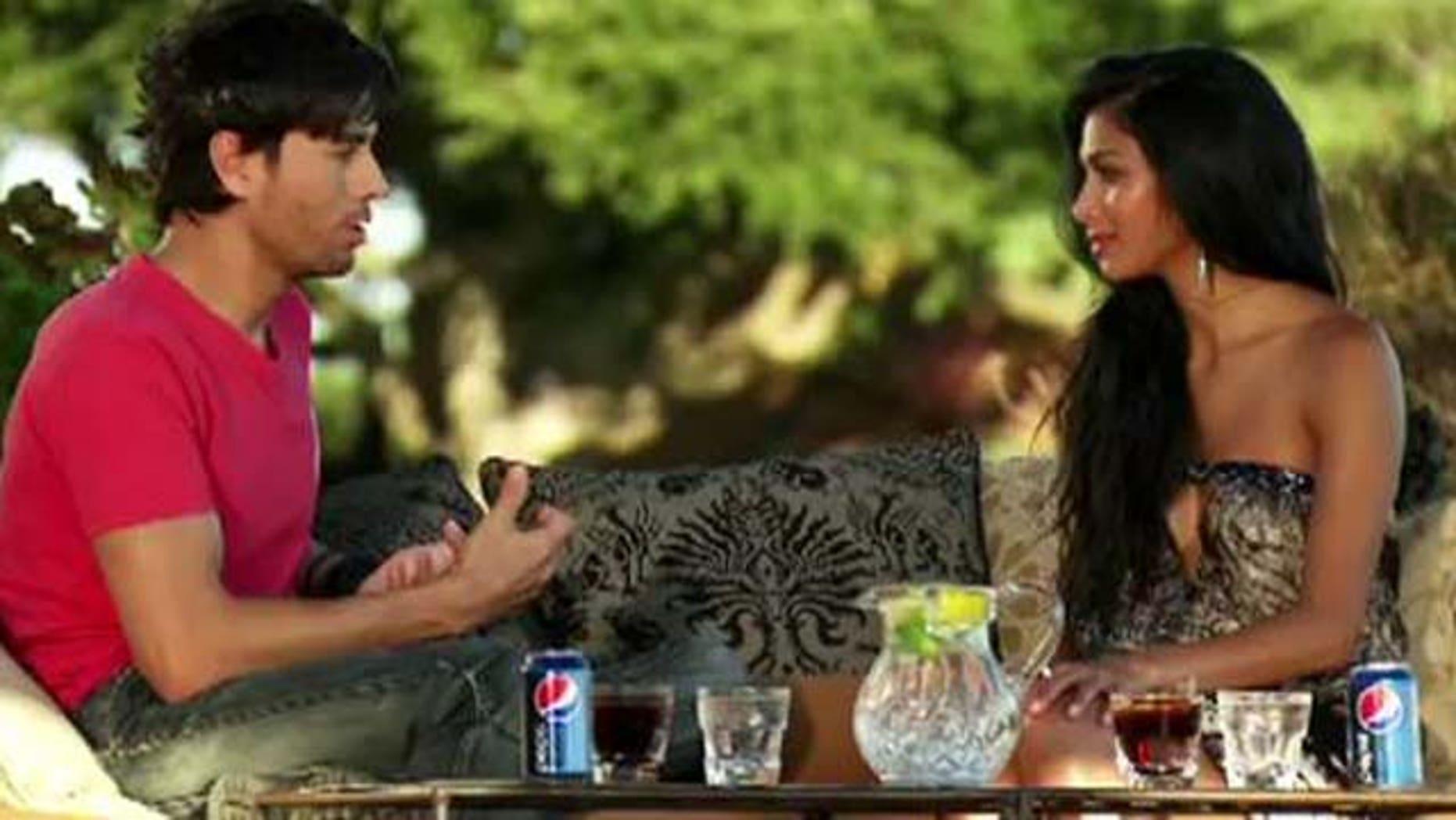 Oct. 16, 2011: Enrique Iglesias gives Nicole Scherzinger advice on contestant Josh Krajcik Sunday evening at her home in Malibu, Calif.