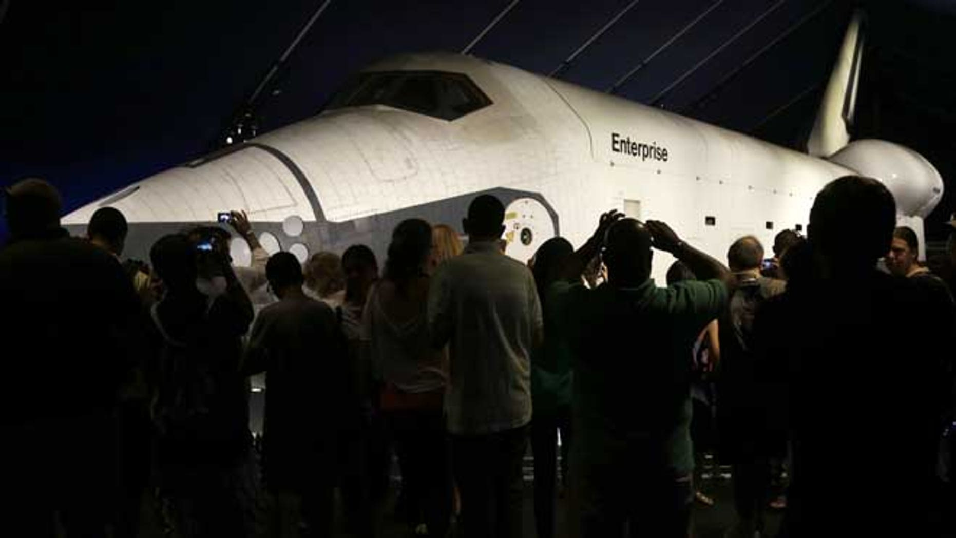 July 10, 2013: Visitors look at the space shuttle Enterprise in its newly completed pavilion on the deck of the Intrepid Sea, Air & Space Museum in New York.