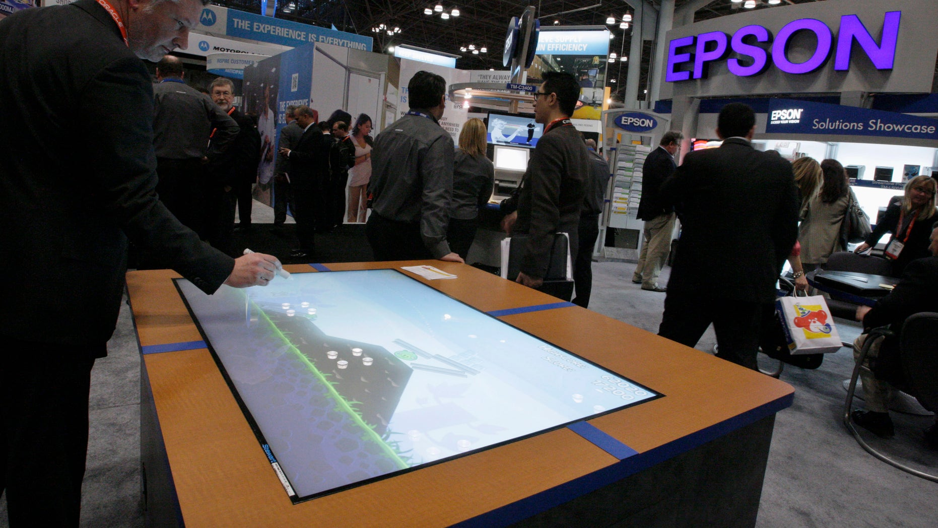 File photo. A man visits the Epson stand at the National Retail Federation's Annual Convention and Expo in New York January 2012.