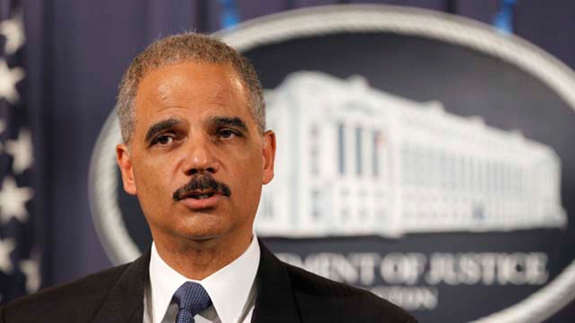 Attorney General Eric Holder speaks during a news conference at the Justice Department in Washington, Tuesday, Oct. 11, 2011. Holder announced that two individuals have been charged in New York for their alleged participation in a plot directed by elements of the Iranian government to murder the Saudi Ambassador to the United States with explosives while the ambassador was in the United States. (AP Photo/Haraz N. Ghanbari)