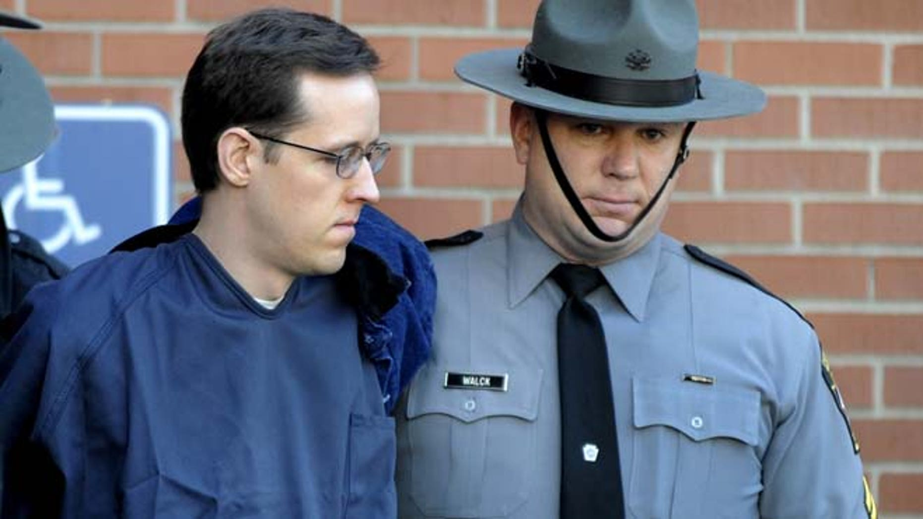 Jan. 5, 2015: In this file photo, Eric Frein, left, is led from the Pike County Courthouse after his preliminary hearing in Milford, Pa. (AP)