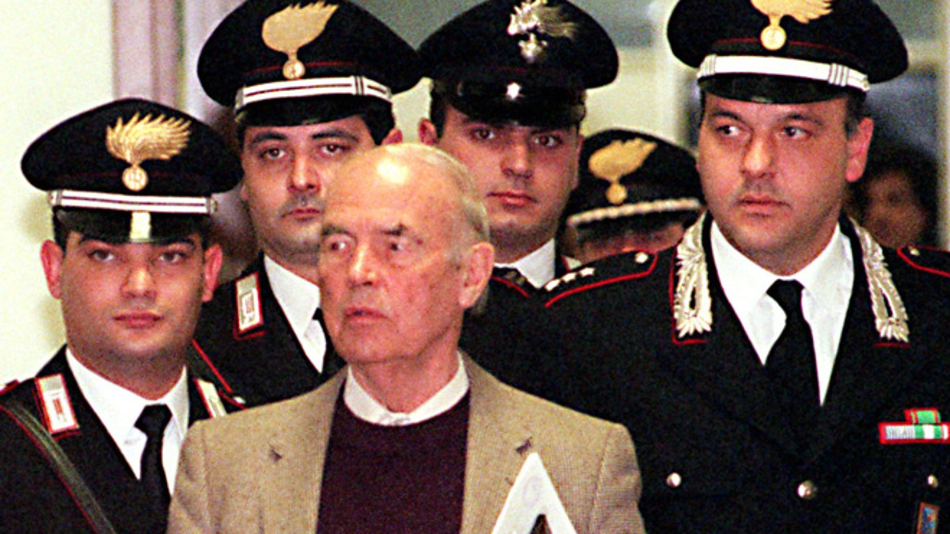 In this Thursday, Dec. 7, 1995 file photo, Former Nazi SS officer Erich Priebke enters the military court in Rome. Priebke, a former Nazi SS captain, was sentenced to life in prison for his role in one of the worst atrocities by German occupiers in Italy during World War II. In 1994, Priebke was extradited to Italy from Argentina and put on trial for his role in the 1944 massacre outside Rome. Nazi forces killed 335 civilians to avenge an attack by resistance fighters that killed 33 members of a Nazi military police unit a day earlier. Priebke admitted shooting two people and rounding up victims, but insisted he was only following orders.