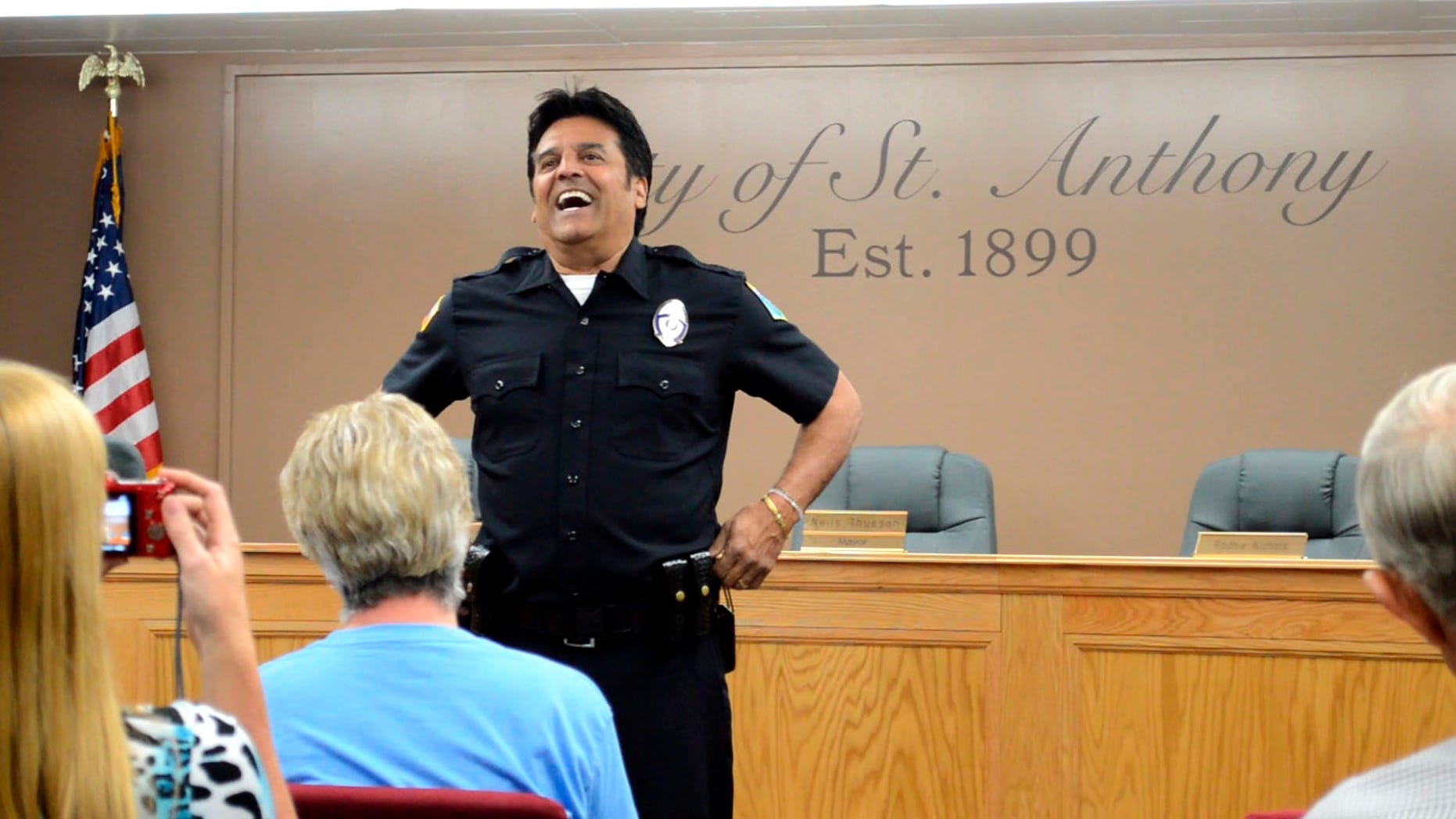 """In this Saturday, July 2, 2016, photo famed """"CHiPs"""" police officer Erik Estrada mets St. Anthony residents to discuss his efforts with the St. Anthony Police Department to stop internet enticement of children at St. Anthony City Hall. Estrada has spent the past decade working with various law enforcement departments to keep kids safe online. Following his induction Estrada as a now a St. Anthony Police Department reserve officer, he told how important it is to teach children what not to do while on the web. (Lisa Dayley-Smith/Rexburg Standard Journal via AP) MANDATORY CREDIT"""