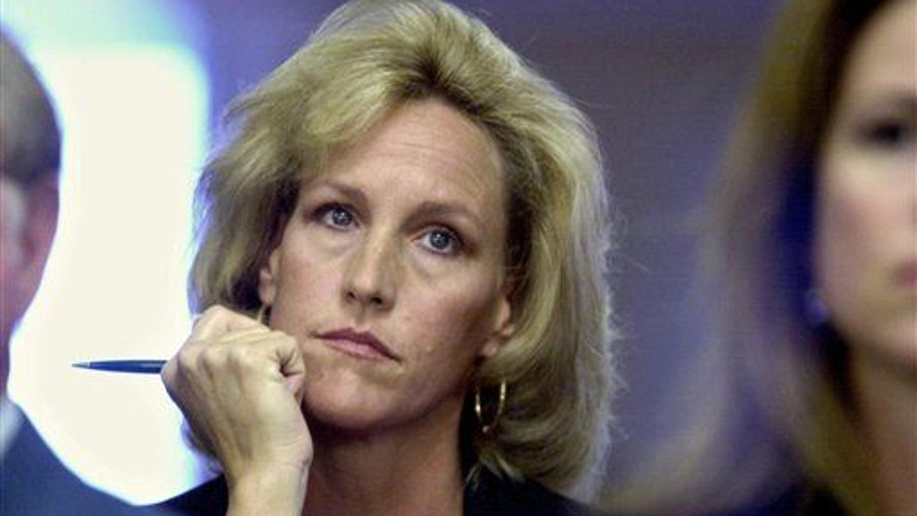 In a Friday, September 15, 2000 photo, Erin Brockovich listens to a presentation to the Los Angeles City Council by the Los Angeles Department of Water and Power.