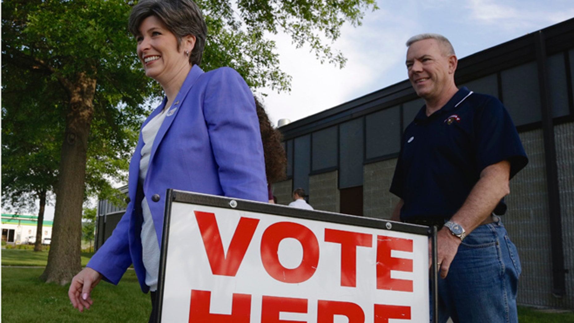 June 3, 2014: GOP Senate candidate Joni Ernst and husband Gail, right, leave a polling station in Red Oak, Iowa.