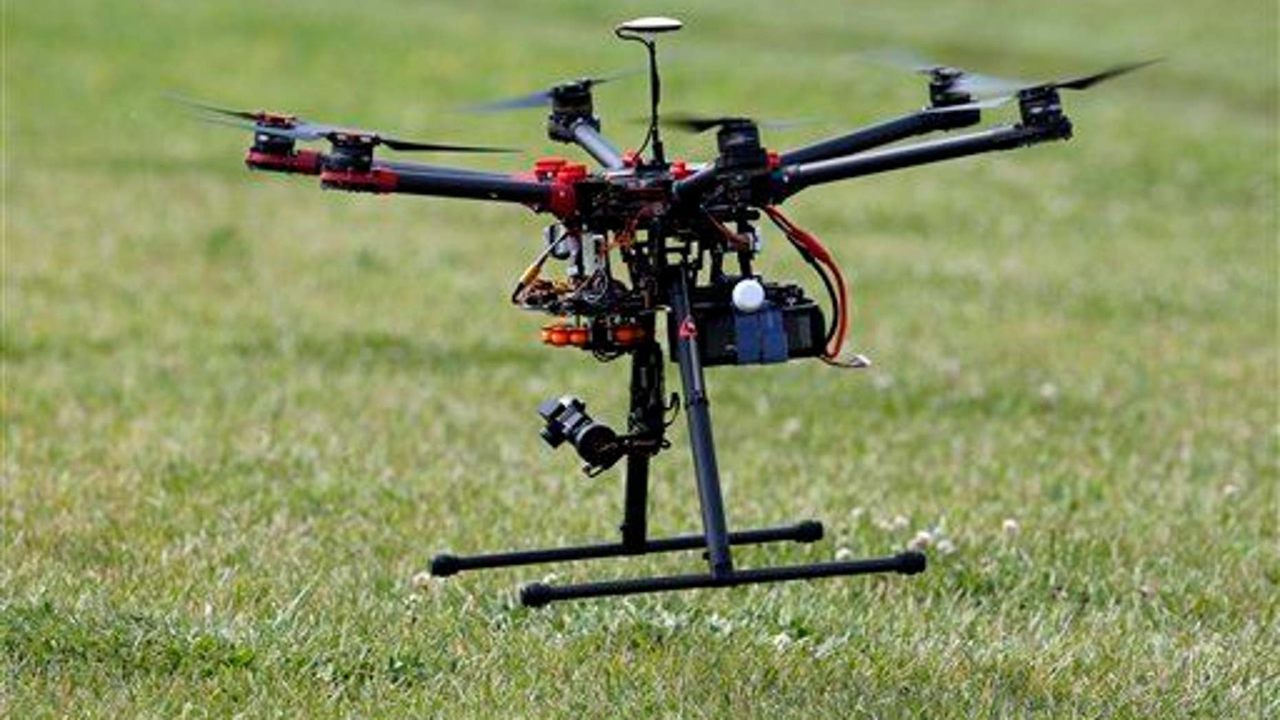 In this photo taken June 11, 2015, a hexacopter drone is flown during a demonstration in Cordova, Md.