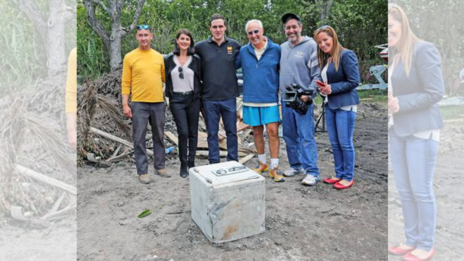 Pablo Escobar's safe at the feet of its new owner, Christian de Berdouare (center). (Photo: Used with permission of Christian de Berdouare)