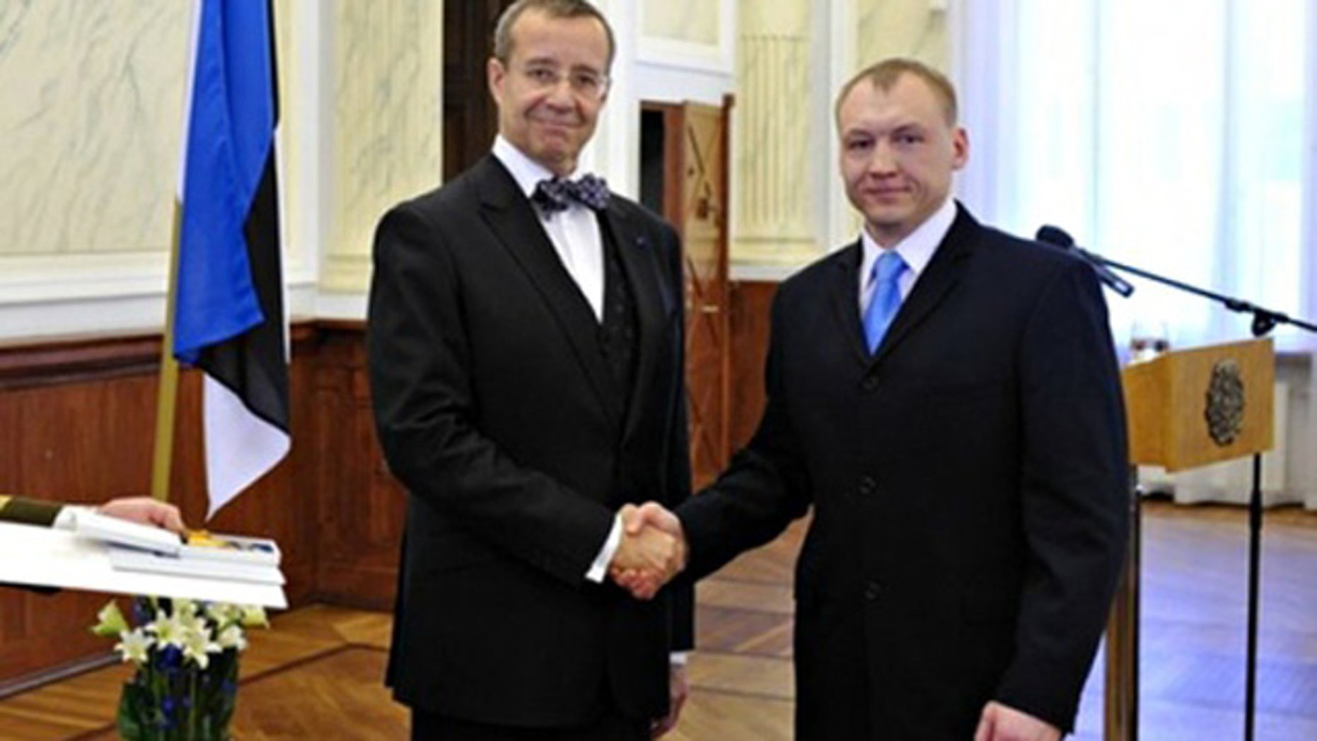 This 2010 photo shows Eston Kohver, right, receivning a decoration from Estonia's President Toomas Hendrik.
