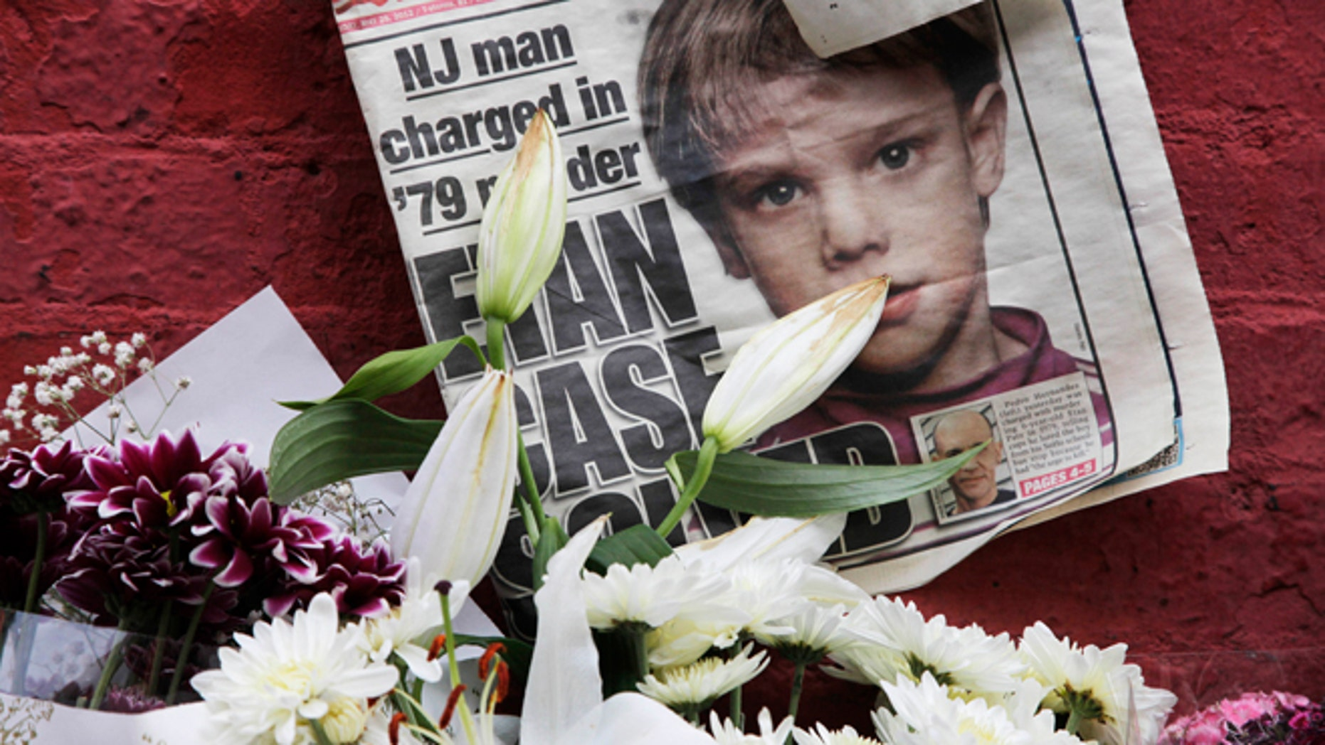 FILE - This May 28, 2012, file photo shows a newspaper with a photograph of Etan Patz that is part of a makeshift memorial in the SoHo neighborhood of New York. Jury selection is set to start Monday, Jan. 5, 2015, in Hernandezâs murder trial. As the murder case surrounding Patz' notorious 1979 disappearance heads to trial, missing-childrenâs advocates see it as proof that such cases still can be pursued after decades. (AP Photo/Mark Lennihan, File)