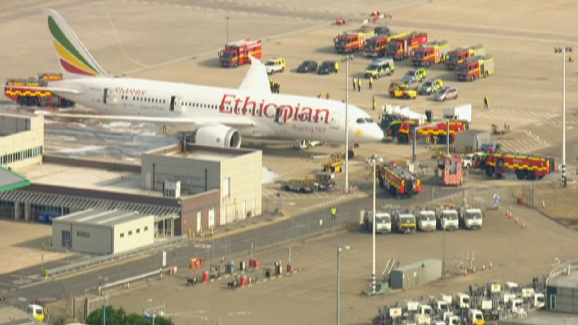 July 12, 2013 - Still taken from SKY NEWS video of emergency workers responding to a fire on an Ethiopian Airlines plane at London's Heathrow Airport. There were no passengers nor crew on board and no injuries were reported.