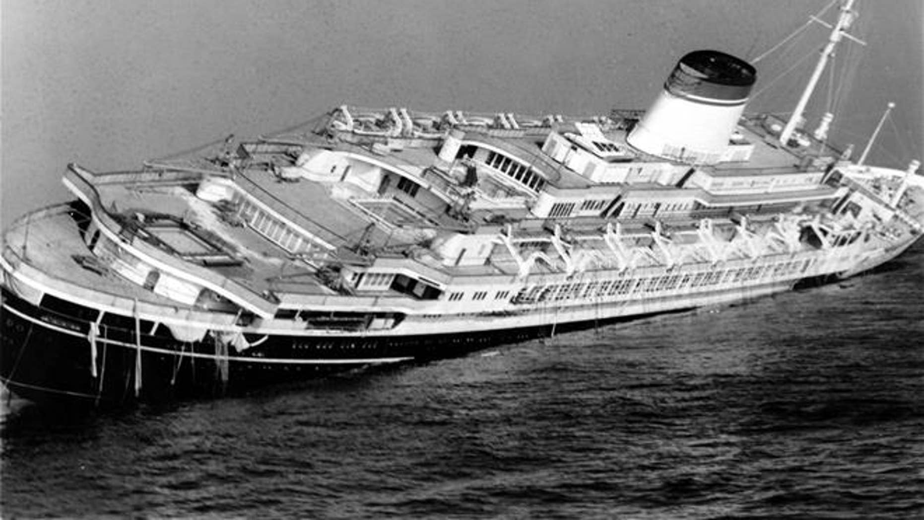 The Andrea Doria keels far over to starboard before sinking to the bottom of the Atlantic in 1956.