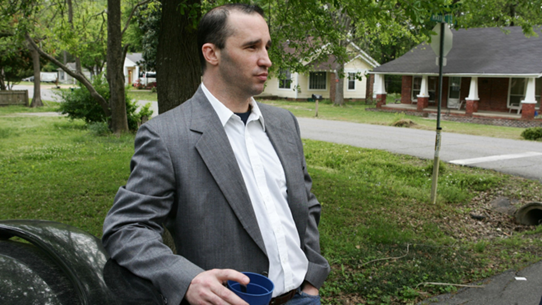 April 23, 2013: In this Tuesday file photo, Everett Dutschke stands in the street near his home in Tupelo, Miss., and waits for the FBI to arrive and search his home. Dutschke, charged with making and possessing ricin as part of the investigation into poison-laced letters sent to President Barack Obama and others was expected to appear in court Monday April 29, 2013.
