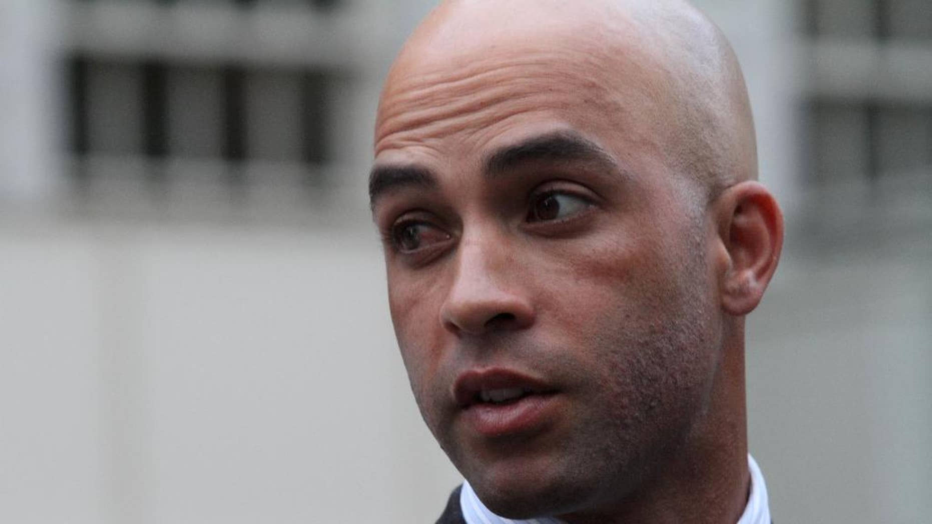 James Blake, center left, talks to members of the media outside City Hall in New York after leaving the building Monday, Sept. 21, 2015. Blake, a former tennis star, was tackled during a mistaken arrest by a New York City police officer on Sept. 9. (AP Photo/Tina Fineberg)