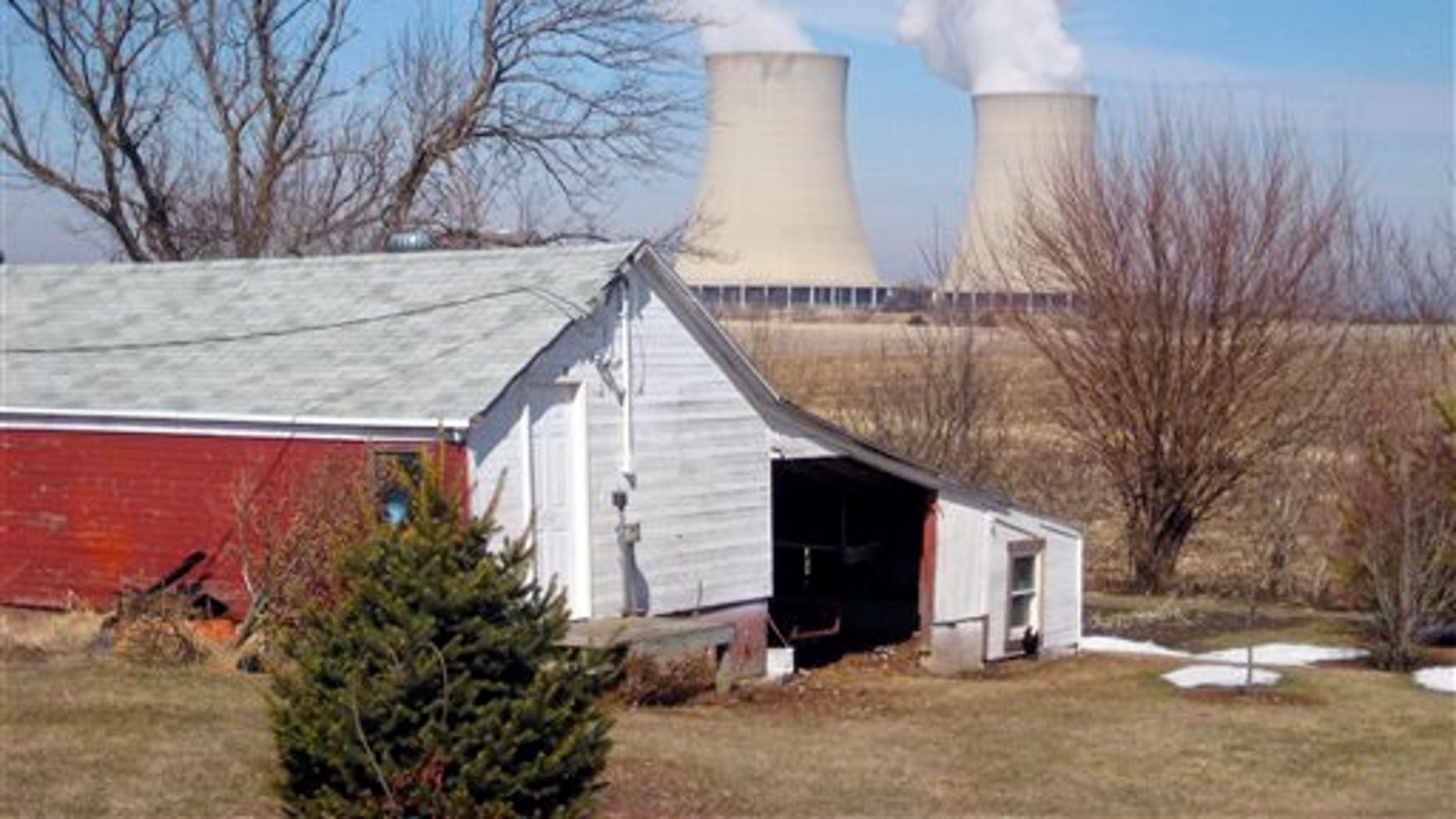 In this March 16, 2011 file photo, steam escapes from Exelon Corp.'s nuclear plant in Byron, Ill. (AP Photo/Robert Ray, File)