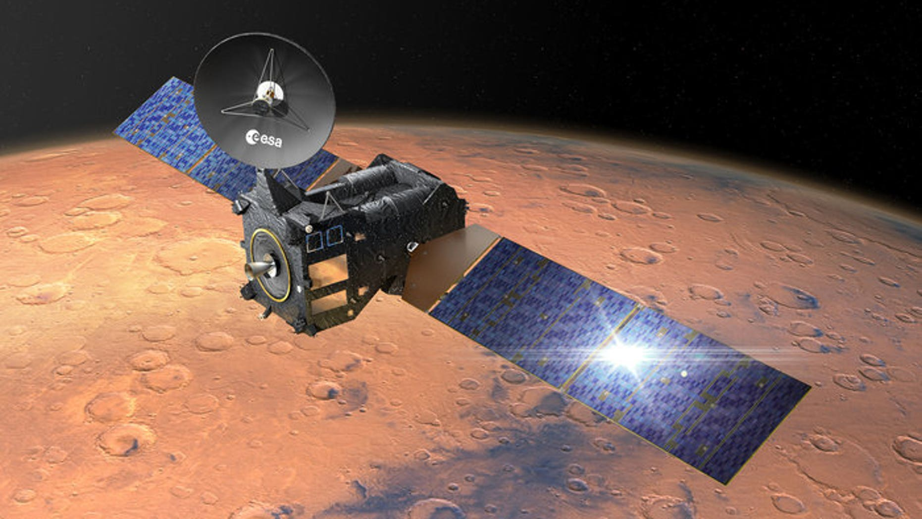 An artist's depiction of ESA's Trace Gas Orbiter at work around Mars.