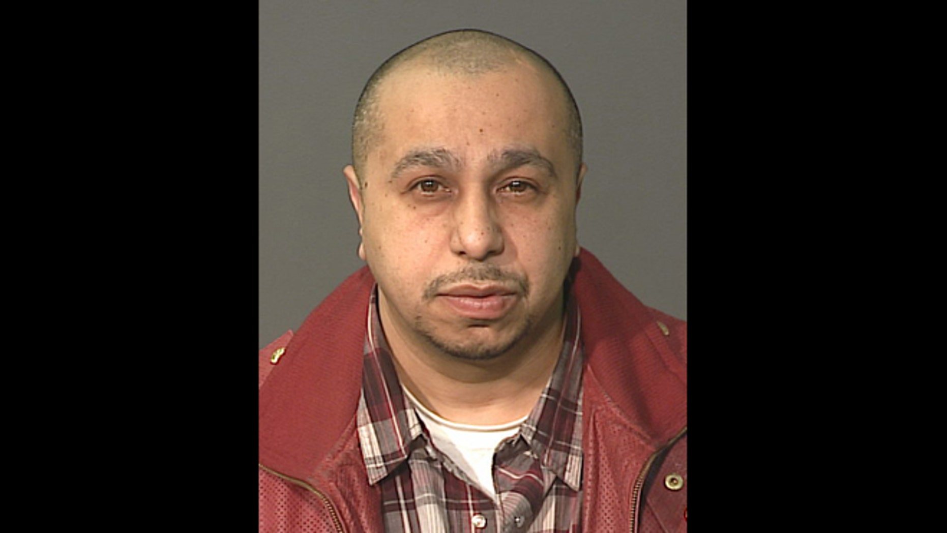 In this undated file photo released by the New York City Police Department, Julio Acevedo is shown. On Tuesday, March 19, 2013, a New York City prosecutor says that manslaughter has been added to the charges against Acevedo in the car crash that killed a pregnant woman and her husband earlier this month.