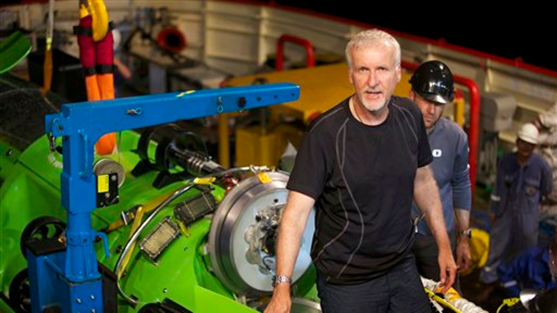 This February 2012 photo, provided by National Geographic, shows explorer and filmmaker James Cameron emerging from the hatch of DEEPSEA CHALLENGER during testing of the submersible in Jervis Bay, south of Sydney, Australia.
