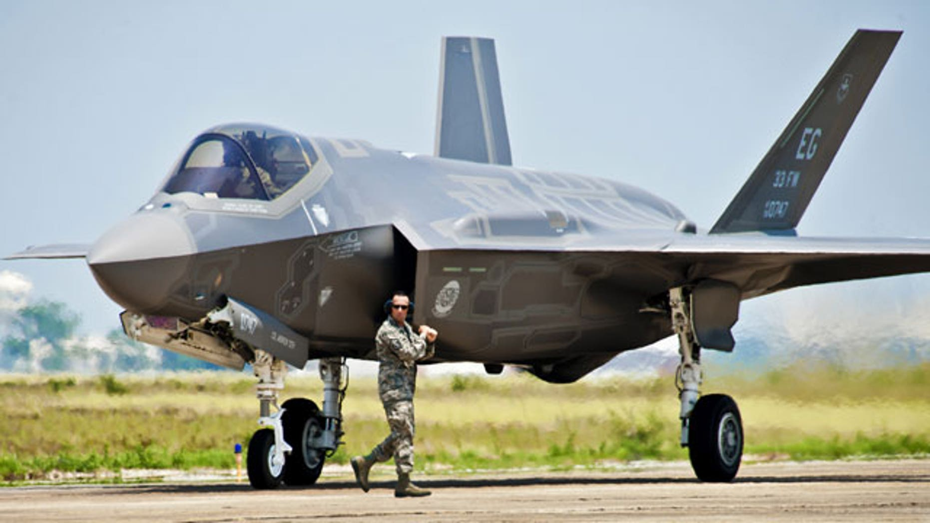 FILE: A 33rd Fighter Wing aircraft maintainer moves by the Department of Defense's newest aircraft, the U.S. Air Force F-35 Lightning II joint strike fighter (JSF), before giving the pilot an order to taxi the aircraft at Eglin Air Force Base, Fla.
