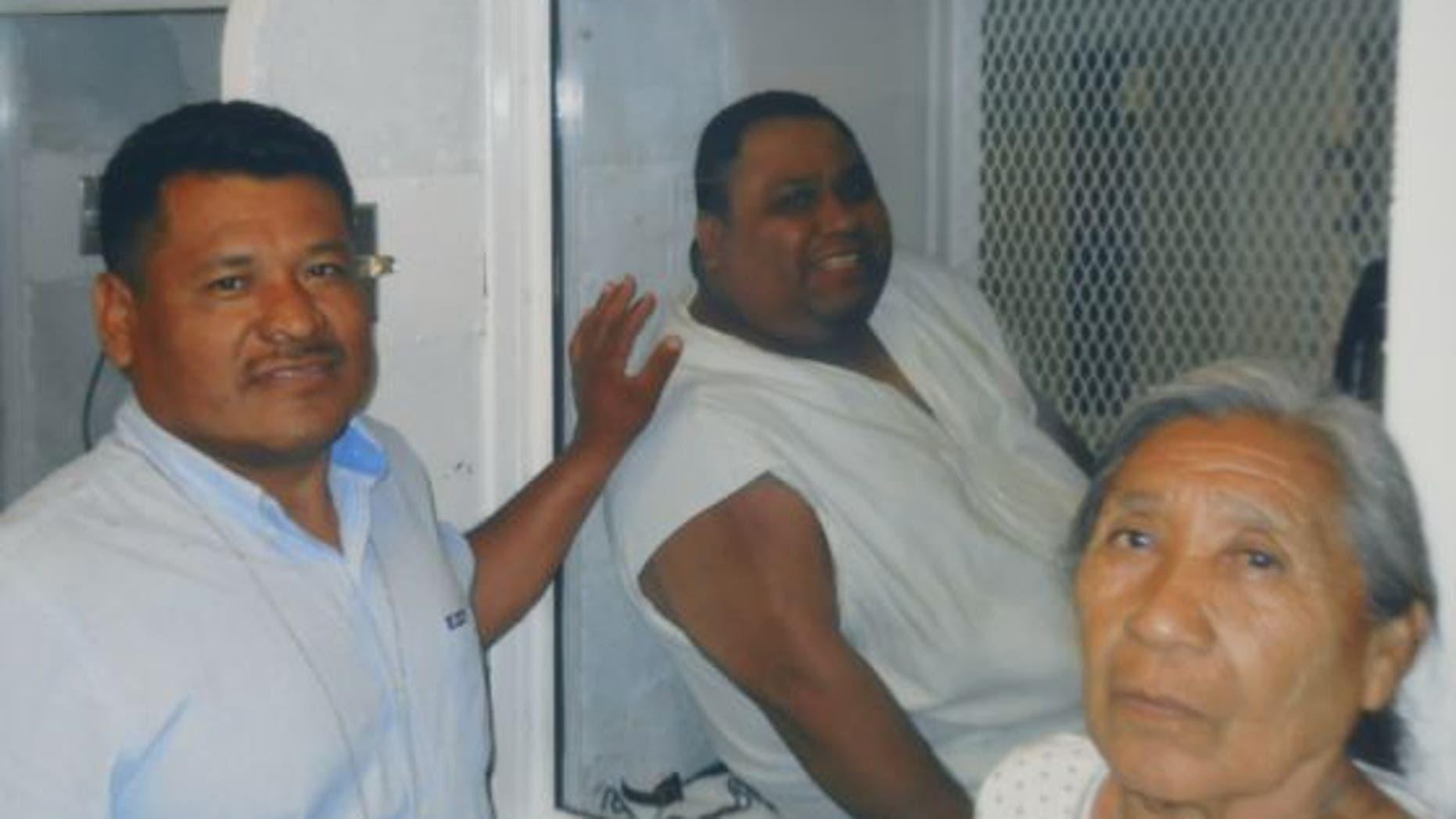 Ramiro Hernandez Llanas, center, with members of his family.