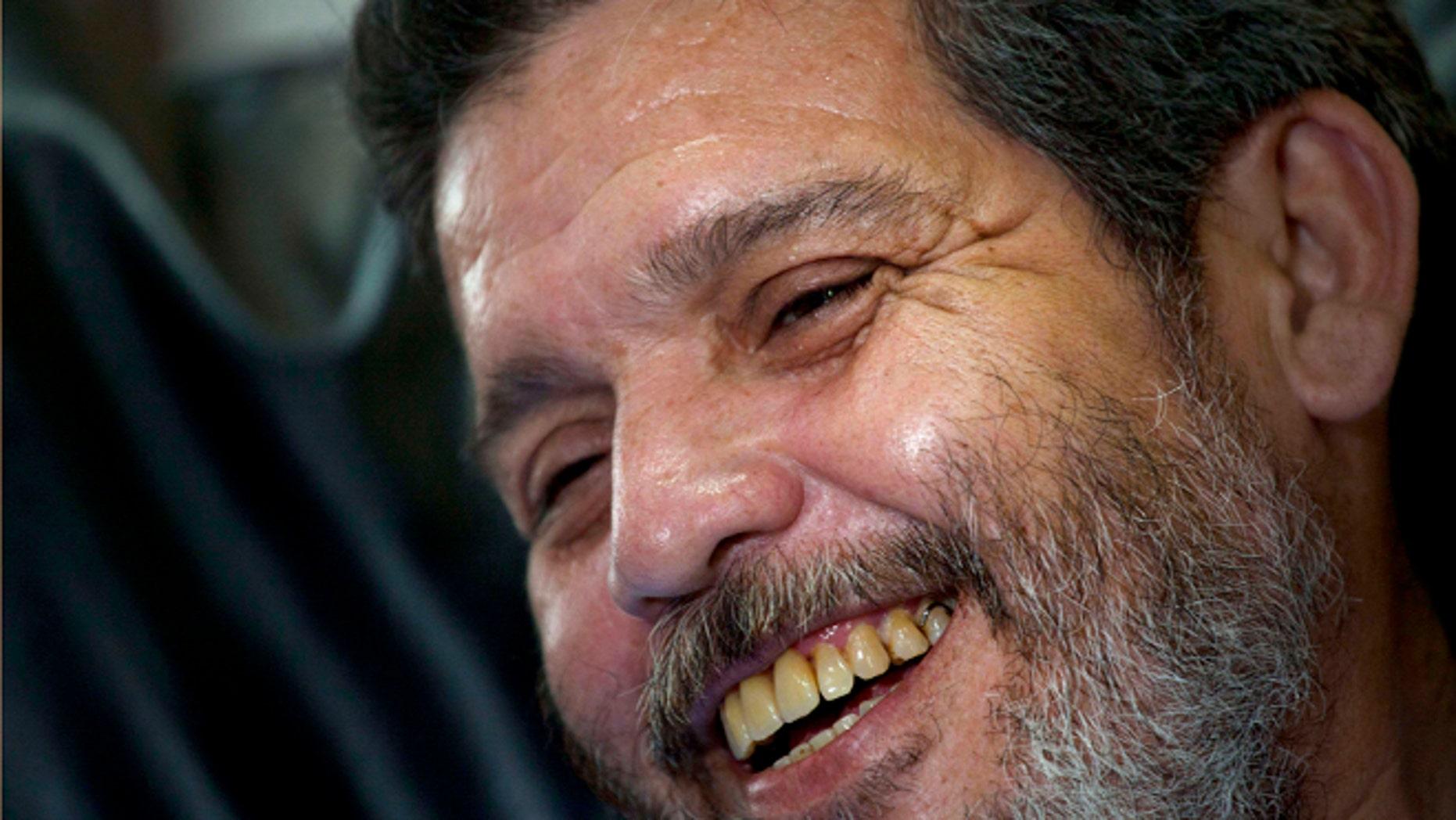 Marco Leon Calarca, spokesman and member of FARC smiles during an interview in Havana, Cuba, Friday, Sept 7, 2012. (AP Photo/Ramon Espinosa)