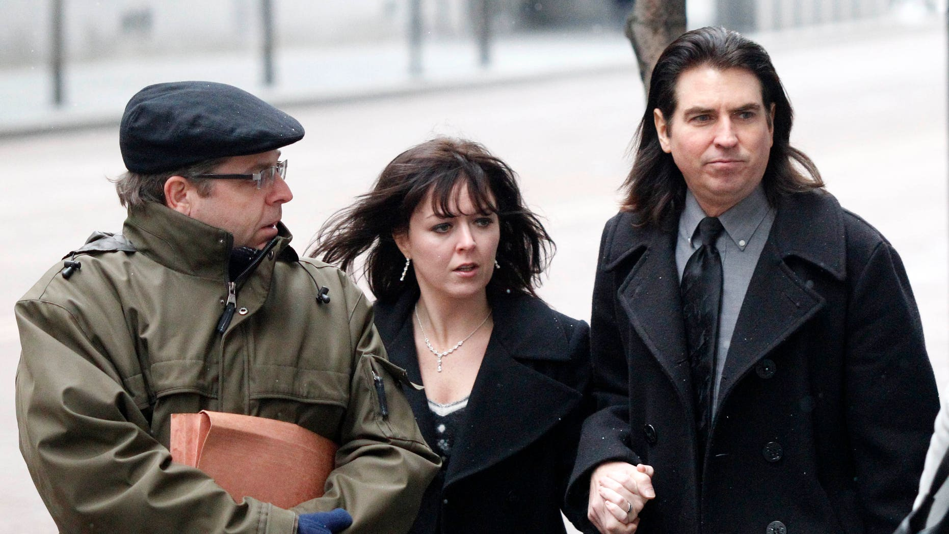Jan. 6: Shawn Begolly, right, walks to federal court for a detention hearing for his son, Emerson Begolly with his wife, Tiffani, center, and a public defender investigator, in Pittsburgh. Emerson Begolly is being held on charges he bit two FBI agents while carrying a loaded gun on Jan. 4.