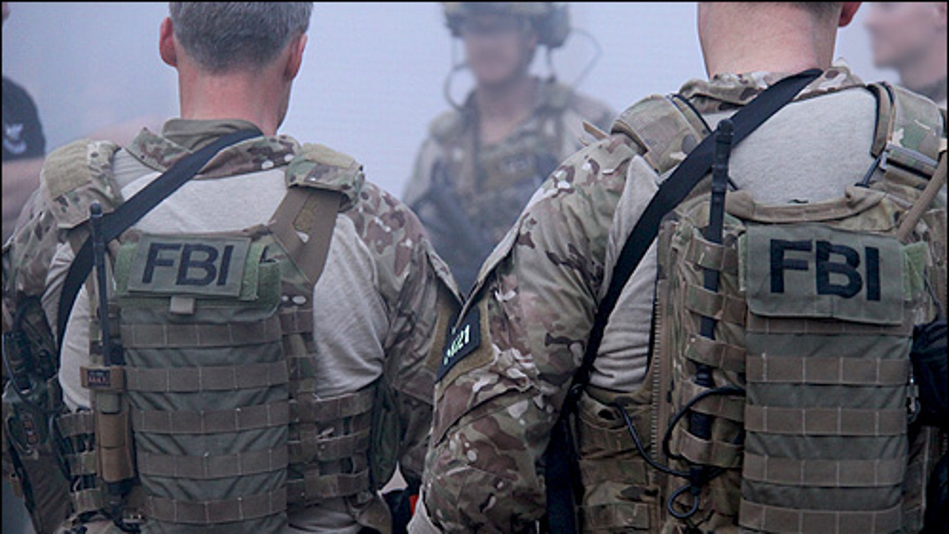 Members of the FBI's Hostage Rescue Team, or HRT, debrief after a training exercise at their headquarters in Quantico, Va.