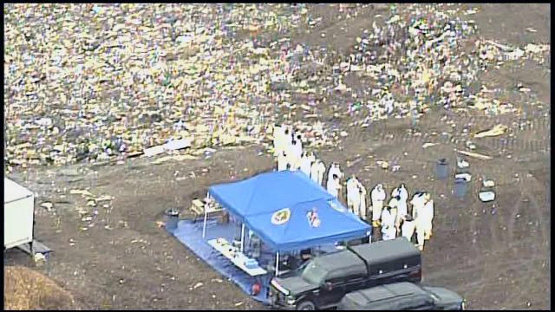 In this aerial photo FBI investigators are seen searching a landfill near the UMass-Dartmouth campus where Boston Marathon bombing suspect  Dzhokhar Tsarnaev was a student.