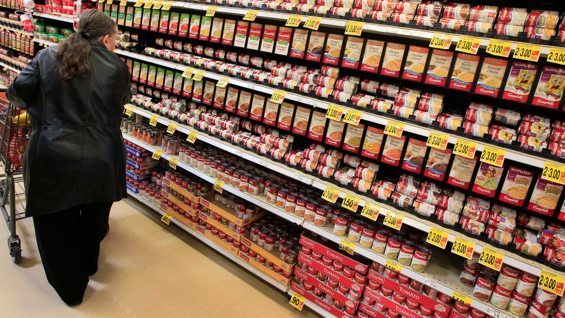A shopper walks down the canned soup aisle at a grocery store in Cincinnati. (AP Photo/Al Behrman, File)
