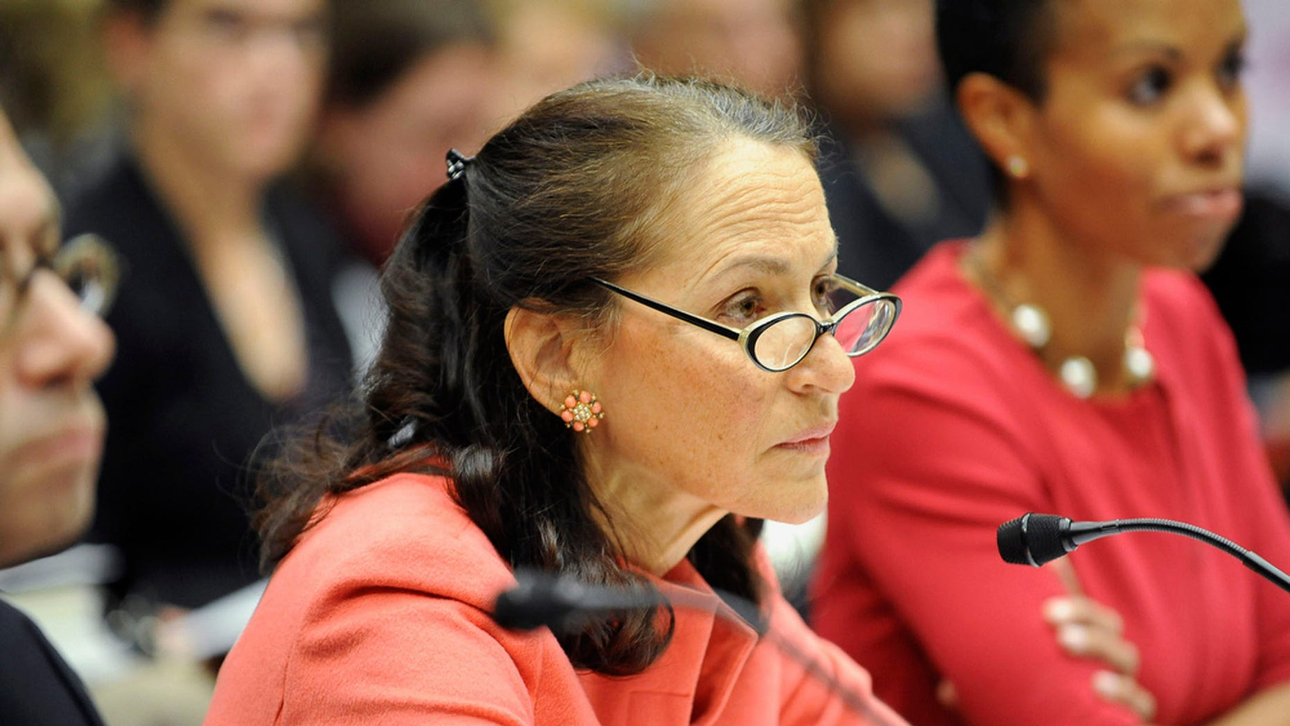 """Margaret Hamburg, Commissioner of the Food and Drug Administration, listens during a House Energy and Commerce Oversight and Investigations Subcommittee hearing on """"The Fungal Meningitis Outbreak: Could It Have Been Prevented"""" at the Rayburn House Office Building in Capitol Hill."""