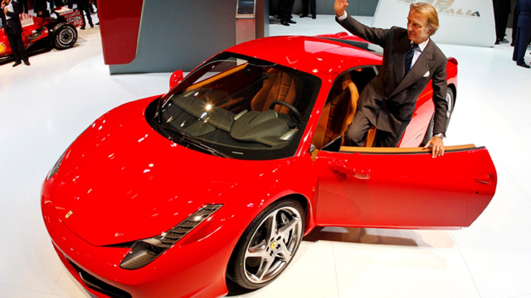President of Fiat group Luca di Montezemolo stands next to a Ferrari 458 Italia
