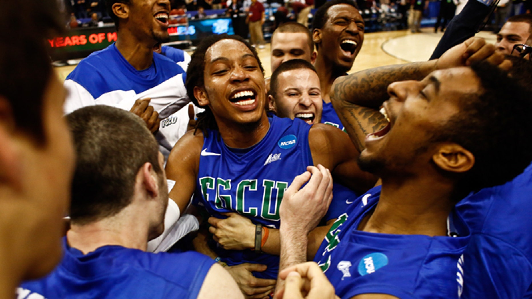 Florida Gulf Coast players celebrate after winning a third-round game against San Diego State in the NCAA college basketball tournament, Sunday, March 24, 2013, in Philadelphia. Florida Gulf Coast won 81-71. (AP Photo/Naples Daily News, Scott McIntyre)