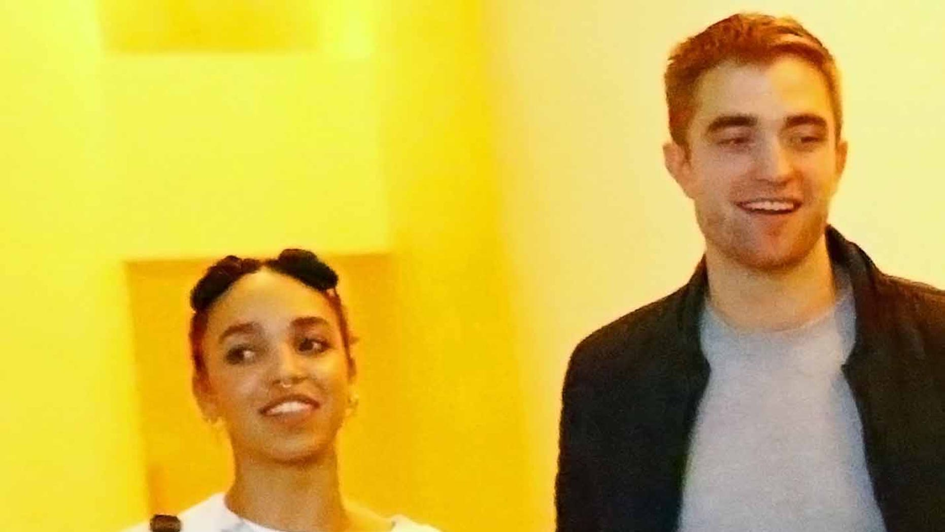 MIAMI, FL - DECEMBER 04:  (L-R) Singer FKA Twigs and Robert Pattinson attend a Surface Magazine Event With Hans Ulrich Obrist And FKA Twigs at Edition Hotel on December 4, 2014 in Miami, Florida.  (Photo by Astrid Stawiarz/Getty Images for Surface)
