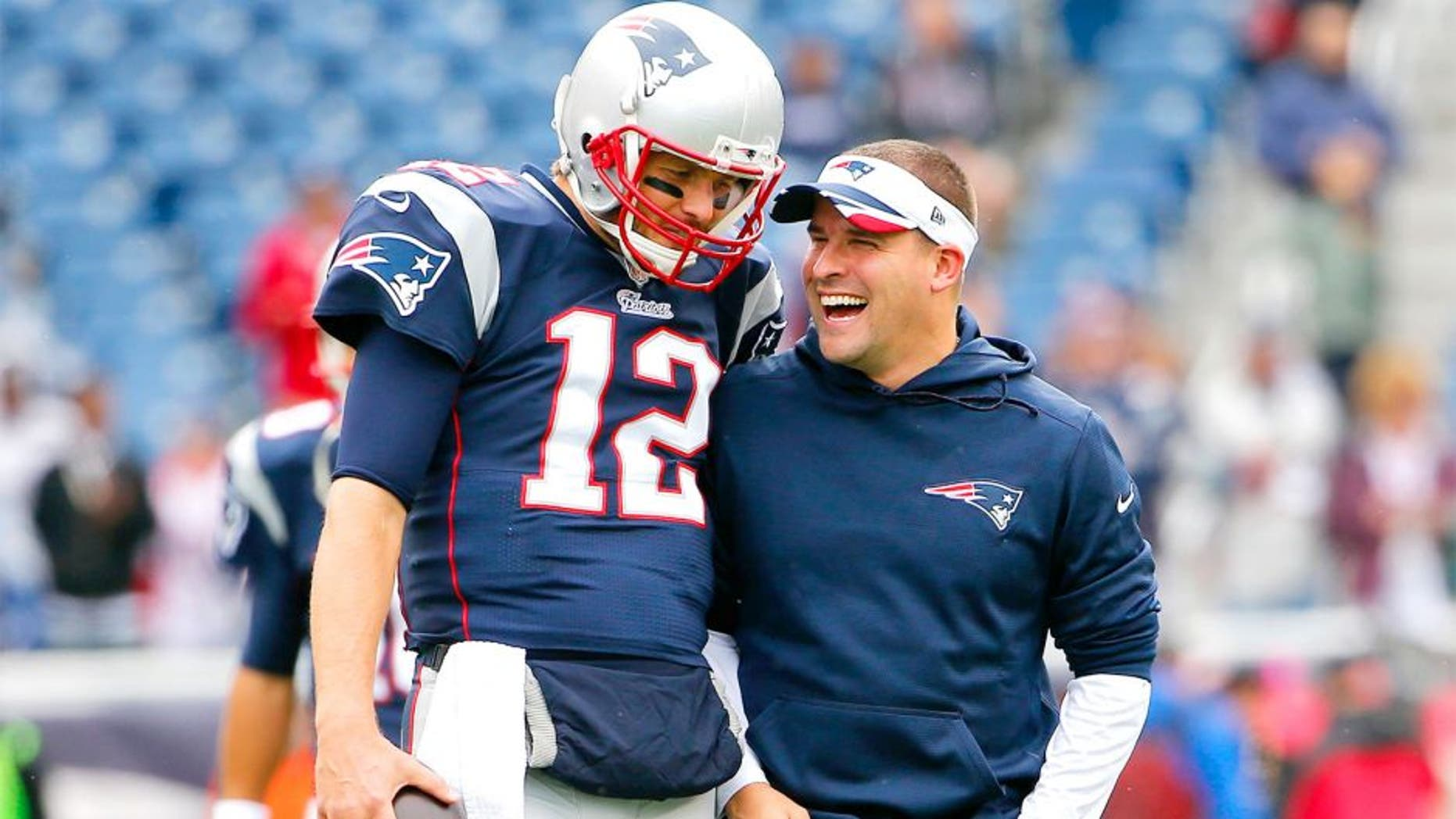 Oct 26, 2014; Foxborough, MA, USA; New England Patriots quarterback Tom Brady has a laugh with offensive coordinator Josh McDaniels before the game between the New England Patriots and the Chicago Bears at Gillette Stadium. Mandatory Credit: Winslow Townson-USA TODAY Sports
