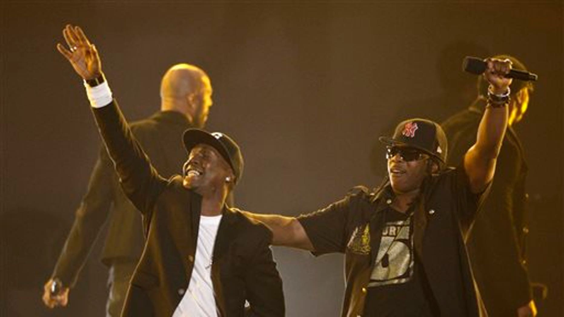 FILE - In this Nov. 30, 2011, file photo, Grandmaster Flash, left, and Scorpio perform at the Grammy Nominations Concert in Los Angeles. New York City police have launched an investigation after hip-hop heavyweight Grandmaster Flash's car was given away at a Manhattan parking garage. A New York Police Department spokesman says Friday, July 24, 2015, that the incident happened July 16 around 7:30 p.m. (AP Photo/Matt Sayles, File)